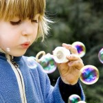 Photo of young girl blowing bubbles