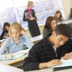 Photo of high school students taking a test